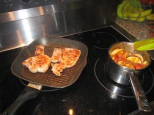 Food Travelist Pork Chops With Apples And Onions On The Stovetop