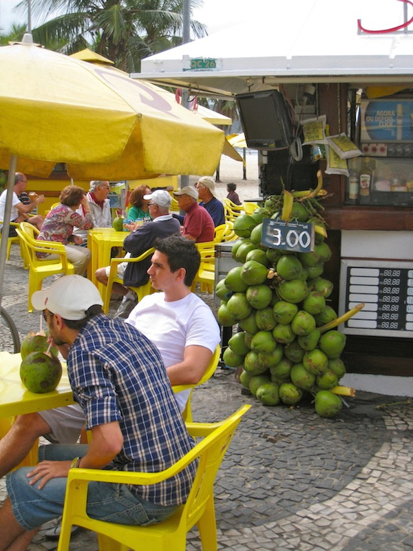 Street food around the world coconuts on Cobacabana Beach.