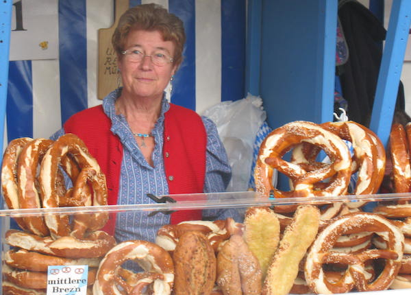 Street Food around the world pretzel lady at Oktoberfest.