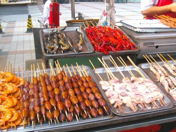 Asian Food Beijing Night Market Lots of Stuff on Sticks