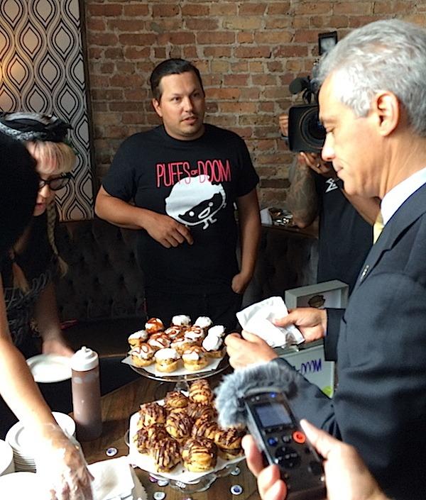 Chicago Mayor Rahm Emanuel having a taste