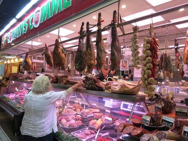 meat-vendor-at-victor-hugo-market-tolouse-france