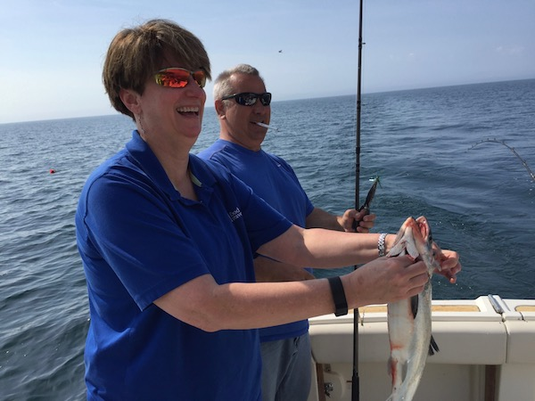 Sue Catching Coho Salmon Fishing Lake Michigan In Kenosha