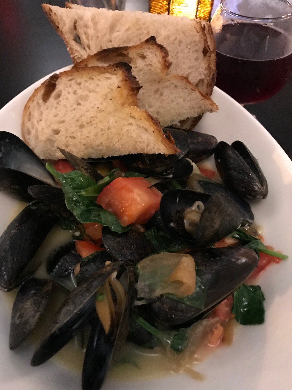 Michigan Beer Mussels with tomatoes caramelized onions roasted garlic and spinach Green Well Grand Rapids