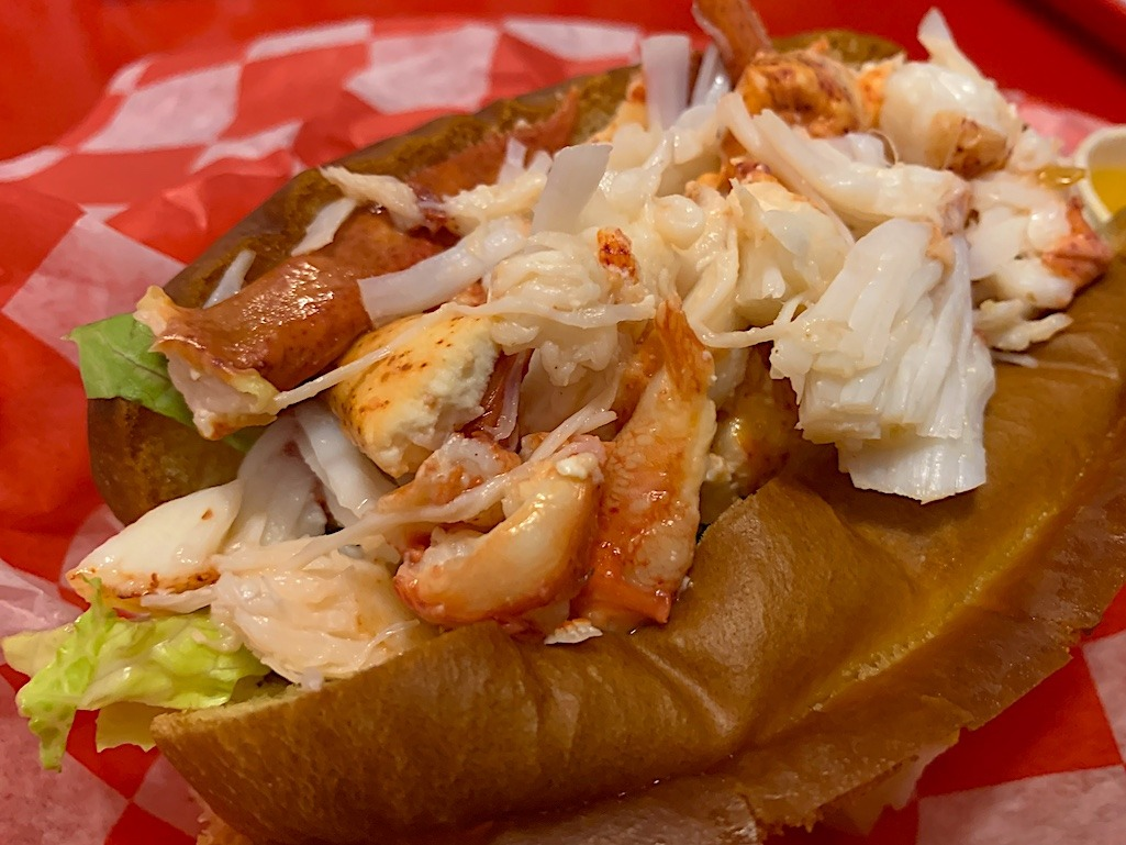 Delicious Lobster Roll at High Roller Portland Maine Best Places To Visit For Food Travel